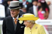 Queen Elizabeth II and Prince Philip, Duke of Edinburgh arrive in the parade ring at Royal Ascot 2016 at Ascot Racecourse on June 14, 2016 in Ascot, England.