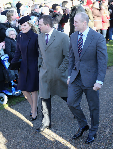 Autumn Phillips, Peter Phillips and Mike Tindall leave the Christmas Day service at Sandringham on December 25, 2013 in King's Lynn, England.
