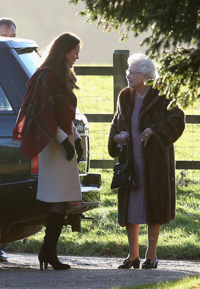 Queen Elizabeth II (R), and Catherine, Duchess of Cambridge (L) arrive at the Christmas Day service at Sandringham on December 25, 2013 in King's Lynn, England.