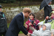 Prince Harry meets members of the public as he attends a Christmas Day church service at Sandringham on December 25, 2015 in King's Lynn, England.