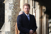 Prince Harry attends a Christmas Day church service at Sandringham on December 25, 2016 in King's Lynn, England.