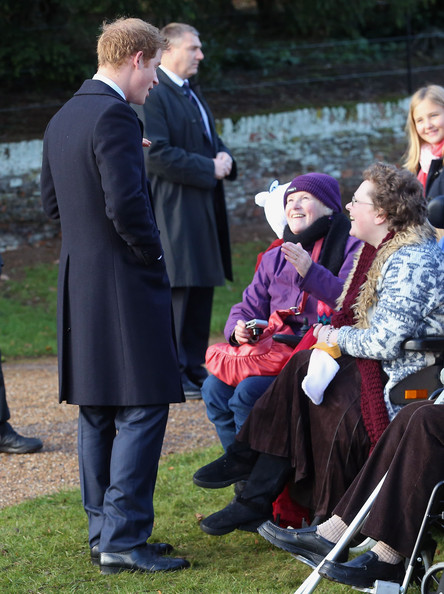 Prince Harry stops to chat to members of the public as he leaves the Christmas Day Service at Sandringham Church on December 25, 2014 in King's Lynn, England.