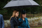 Princess Beatrice and Princess Eugenie attends a Christmas Day church service at Sandringham on December 25, 2015 in King's Lynn, England.
