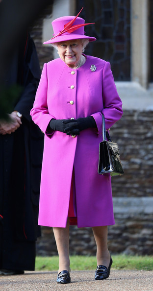 Queen Elizabeth II leaves the Christmas Day Service at Sandringham Church on December 25, 2014 in King's Lynn, England.