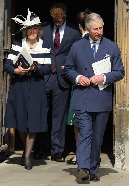 Prince Harry, Camilla, Duchess of Cornwall and Prince Charles, Prince of Wales leaves a thanksgiving service for the Queen Mother and Princess Margaret at St George's Chapel on March 30, 2012 in Windsor, England.