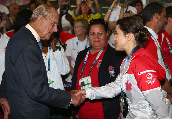 Prince Phillip; Duke of Edinburgh is greeted by Canadian athlete Isabelle Després  during a visit to the Athletes Village during the Commonwealth games on July 24, 2014 in Glasgow, Scotland.
