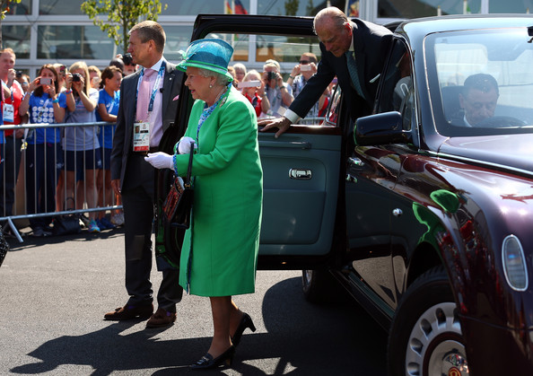 Queen Elizabeth II and Prince Phillip, Duke of Edinburgh are seen as they arrive to visit the Athletes Village during the Commonwealth games on July 24, 2014 in Glasgow, Scotland.