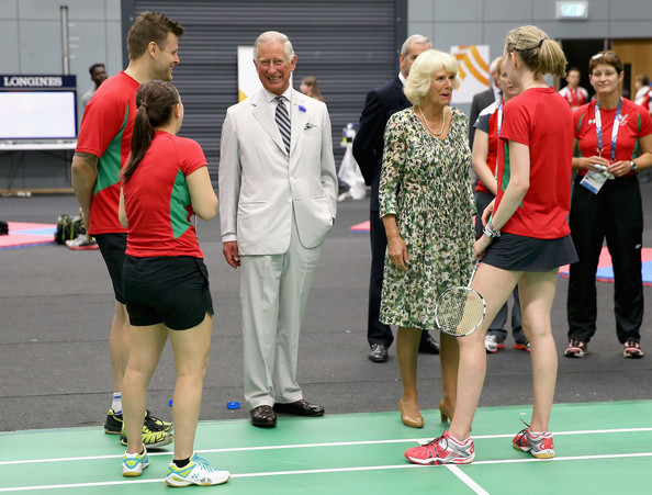 Prince Charles, Prince of Wales and Camilla, Duchess of Cornwall meet Welsh Commonwealth badminton players during a visit to the Emirates Arena and Chris Hoy Velodrome ahead of the start of the Commonwealth games on July 23, 2014 in Glasgow, Scotland.