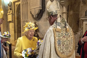 Queen Elizabeth II speaks to the Dean of Windsor, The Right Reverend David Conner KCVO as they attend the traditional Royal Maundy Service at St George's Chapel on April 18, 2019 in Windsor, England.