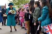 Queen Elizabeth II meets local children following the Royal Maundy service at Leicester Cathedral on April 13, 2017 in Leicester, England. The Queen & Duke of Edinburgh travelled by car from Leicester station along Humberstone Gate, High Street and Jubilee Square.