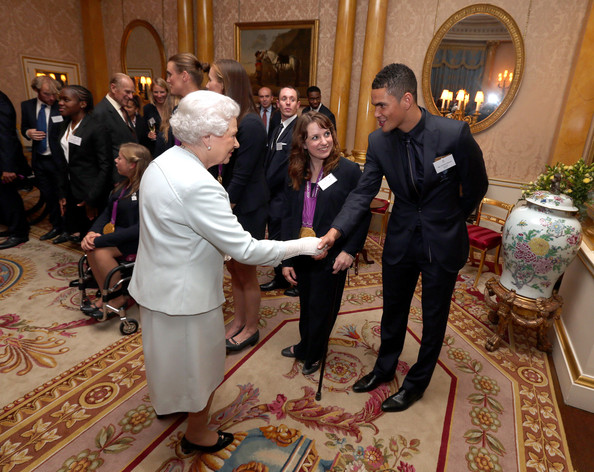 Queen Elizabeth II meets boxer Anthony Ogogo during a reception for the Team GB Olympic and Paralympic medalists at Buckingham Palace on October 23, 2012 in London, England.