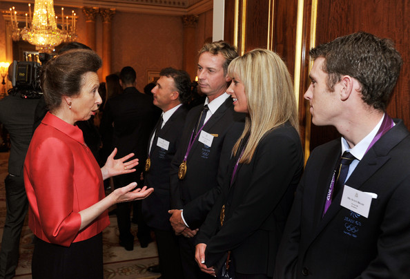 Princess Anne, Princess Royal (L) talks to (L-R) Carl Hester, Charlotte Dujardin and Scott Brash during a reception held for Team GB Olympic and Paralympic London 2012 medalists at Buckingham Palace on October 23, 2012 in London, England.