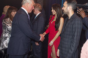 (L-R) Prince Charles, Prince of Wales meets cast members Cheryl Cole and Dynamo after attending a one off performance of 'We Are Most Amused and Amazed' in aid of The Prince's Trust and in celebration of His Royal Highness' 70th Birthday at London Palladium on October 22, 2018 in London, England. The show features performances from leading comics, magicians and musicians including, Rowan Atkinson, Bill Bailey, Omid Djalili, Sandi Toksvig, Alistair McGowan and Mischief Theatre, Dynamo, Penn & Teller, The Ehrlich Brothers, Alexander Armstrong, Ben Miller, Kylie Minogue and Downton Abbey's Jim Carter. The two-hour event will be broadcast on ITV at 8pm on November 13th 2018.
