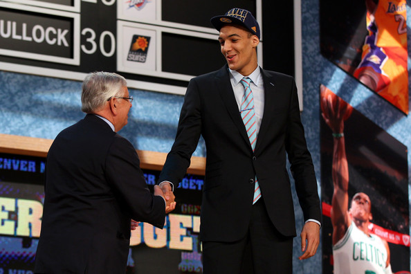 NBA Draft Held in NYC [photo,event,suit,competition event,world,white-collar worker,games,gesture,rudy gobert,david stern,r,user,nyc,france,nba,nba draft,round]