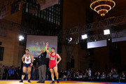 Komeil Ghasemi of Iran is declared the winner as Tervel Dlagnev of the USA loses during the Rumble on the Rails Wrestling on May 15, 2013 at Vanderbilt Hall at Grand Central Terminal in New York City.