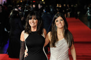 """Vicki Michelle and Louise Michelle attend the UK Premiere of """"Run For Your Wife"""" at Odeon Leicester Square on February 5, 2013 in London, England."""