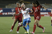 Ekaterina Sochneva #11 of Russia is pressured by Christen Press #23 of the U.S. and Mallory Pugh #2 during the second half of the International Friendly soccer match at Toyota Stadium on April 6, 2017 in Frisco, Texas.