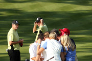 Bubba Watson and Webb Simpsonof the United States pray with their wives and caddies on the 14th green after defeating the Lawrie/Hanson team 5&4 during the Afternoon Four-Ball Matches for The 39th Ryder Cup at Medinah Country Club on September 28, 2012 in Medinah, Illinois.