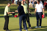 Bubba Watson and Webb Simpsonof the USA greet Paul Lawrie and Peter Hanson of Europe on the 14th green after defeating the Lawrie/Hanson team 5&4 during the Afternoon Four-Ball Matches for The 39th Ryder Cup at Medinah Country Club on September 28, 2012 in Medinah, Illinois.