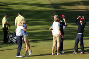 Bubba Watson and Webb Simpsonof the United States celebrate with their wives on the 14th green after defeating the Lawrie/Hanson team 5&4 during the Afternoon Four-Ball Matches for The 39th Ryder Cup at Medinah Country Club on September 28, 2012 in Medinah, Illinois.