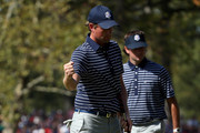 Bubba Watson (R) and Webb Simpson of the USA celebrate a birdie putt on the fifth green during day two of the Afternoon Four-Ball Matches for The 39th Ryder Cup at Medinah Country Club on September 29, 2012 in Medinah, Illinois.