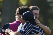 Webb Simpson (R) and Bubba Watson of the USA hug on the 14th green after defeating the team of Rose/Molinari 5&4 during day two of the Afternoon Four-Ball Matches for The 39th Ryder Cup at Medinah Country Club on September 29, 2012 in Medinah, Illinois.