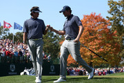 Webb Simpson (R) and Bubba Watson of the USA walk off a green during day two of the Afternoon Four-Ball Matches for The 39th Ryder Cup at Medinah Country Club on September 29, 2012 in Medinah, Illinois.