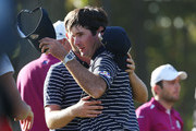 Webb Simpson and Bubba Watson of the USA hug on the 14th green after defeating the team of Rose/Molinari 5&4 during day two of the Afternoon Four-Ball Matches for The 39th Ryder Cup at Medinah Country Club on September 29, 2012 in Medinah, Illinois.
