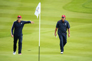 Keegan Bradley (L) and Phil Mickelson of the United States talk during practice ahead of the 2014 Ryder Cup on the PGA Centenary course at the Gleneagles Hotel on September 23, 2014 in Auchterarder, Scotland.