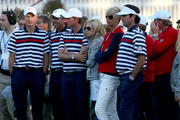(L-R) Jim Furyk, Phil Mickelson, Webb Simpson and Bubba Watson wait with some of their team at the end of the Singles Matches for The 39th Ryder Cup at Medinah Country Club on September 30, 2012 in Medinah, Illinois.
