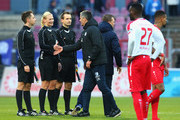 Manager Jens Haertel of Magdeburg (C) shakes hands with referee Bibiana Steinhaus after the 3. Liga match between SC Fortuna Koeln and 1. FC Magdeburg at Suedstadion on November 18, 2017 in Cologne, Germany.