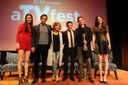 """Presenters Caroline Huey (L) and Rebecca Huey (R) and Spotlight Cast Award Recipients for """"Gotham"""" actors (L-R)  Nathan Darrow, Camren Bicondova, Robin Lord Taylor and Cory Michael Smith pose with the award during Spotlight Cast Award presentations during aTVfest 2016 presented by SCAD on February 5, 2016 in Atlanta, Georgia."""