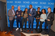 "Damon Gupton, Marvin ""Krondon"" Jones III, Nafessa Williams, Cress Williams, Christine Adams, China Anne McClain, and James Remar pose with the 2018 aTVfest Spotlight Cast Award for 'Black Lightning' on Day 3 of the SCAD aTVfest 2018 on February 3, 2018 in Atlanta, Georgia."