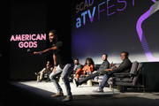 """Ricky Whittle (C) speaks onstage during the the """"All American"""" panel during SCAD aTVfest 2019 at SCADshow on February 8, 2019 in Atlanta, Georgia."""