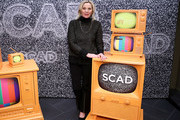 "Kim Cattrall poses with the 2020 Icon Award during the SCAD aTVfest 2020 - ""Filthy Rich"" With Kim Cattrall Icon Award Presentation on February 27, 2020 in Atlanta, Georgia."