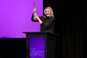 "Kim Cattrall accepts the 2020 Icon Award on stage during the SCAD aTVfest 2020 - ""Filthy Rich"" With Kim Cattrall Icon Award Presentation on February 27, 2020 in Atlanta, Georgia."