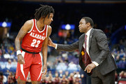 Avery Johnson the head coach of the Alabama Crimson Tide gives instructions to John Petty #23 against the Texas A&M Aggies during the second round of the 2018 SEC Basketball Tournament at Scottrade Center on March 8, 2018 in St Louis, Missouri.