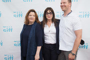 (L-R) Theresa Rebeck, Anjelica Huston and Jim Parrack arrive for the world premiere of the film 'Trouble' at Egyptian Theater, Seattle on June 7, 2017 in Seattle, Washington.