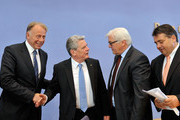 Juergen Trittin (l-r, Greens) Joachim Gauck, Frank-Walter Steinmeier (SPD) and Sigmar Gabriel shake hands after a press conference on June 4, 2010 in Berlin, Germany.  Social Democrats and the Green Party presented Gauck as their candidate in upcoming elections for German president scheduled for June 30, following the unexpected recent resignation of previous President Horst Koehler.