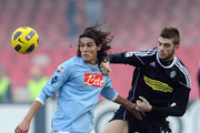 Davide Santon of Cesena (R) tussles with Edinson Cavani of Napoli during the Serie A match between SSC Napoli and AC Cesena at Stadio San Paolo on February 6, 2011 in Naples, Italy.