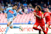 Gianluca Grava (L) of Napoli and Joaquin Larrivey of Cagliari in action during the Serie A match between SSC Napoli and Cagliari Calcio at Stadio San Paolo on April 25, 2010 in Naples, Italy.