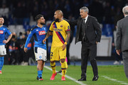 Lorenzo Insigne of SSC Napoli discusses with Arturo Vidal of FC Barcelona during the UEFA Champions League round of 16 first leg match between SSC Napoli and FC Barcelona at Stadio San Paolo on February 25, 2020 in Naples, Italy.