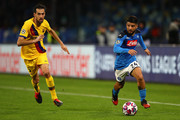 Lorenzo Insigne of Napoli tracked by Sergio Busquets of Barcelona during the UEFA Champions League round of 16 first leg match between SSC Napoli and FC Barcelona at Stadio San Paolo on February 25, 2020 in Naples, Italy.
