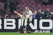 Giorgio Chiellini and Emre Can of Juventus celebrate the 0-2 goal scored by Emre Can during the Serie A match between SSC Napoli and Juventus at Stadio San Paolo on March 3, 2019 in Naples, Italy.