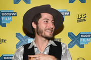 Director Turner Ross poses with the award for the Louis Black Lone Star Award during the SXSW FIlm Awards at the 2015 SXSW Music, FIlm + Interactive Festival at the Paramount Theatre on March 17, 2015 in Austin, Texas.