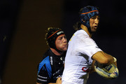 Rob Miller of Sale Sharks grapples with Dion Kingi of Petrarca Rugby during the Amlin Challenge Cup match between Sale Sharks and Petrarca Rugby at Edgeley Park on January 14, 2011 in Stockport, England.