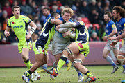 Jared Saunders of Saracens is tackled by Johnny Leota of Sale Sharks during the Aviva Premiership match between Sale Sharks and Saracens at AJ Bell Stadium on February 27, 2016 in Salford, England.