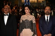 """(FromL) Iranian actor Babak Karimi, Iranian actress Taraneh Alidoosti and Iranian director Asghar Farhadi pose as they arrive on May 21, 2016 for the screening of the film """"The Salesman (Forushande)"""" at the 69th Cannes Film Festival in Cannes, southern France.  / AFP / ALBERTO PIZZOLI"""