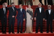 "(FromL) French producer and distributor Alexandre Mallet-Guy, Iranian actor Shahab Hosseini, Iranian director Asghar Farhadi, Iranian actress Taraneh Alidoosti, Iranian actor Babak Karimi and Iranian actor Farid Sajjadihosseini wave as they arrive on May 21, 2016 for the screening of the film ""The Salesman (Forushande)"" at the 69th Cannes Film Festival in Cannes, southern France.  / AFP / Valery HACHE"