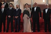 """(FromL) French producer and distributor Alexandre Mallet-Guy, Iranian actor Shahab Hosseini, Iranian director Asghar Farhadi, Iranian actress Taraneh Alidoosti, Iranian actor Babak Karimi and Iranian actor Farid Sajjadihosseini pose as they arrive on May 21, 2016 for the screening of the film """"The Salesman (Forushande)"""" at the 69th Cannes Film Festival in Cannes, southern France.  / AFP / ANNE-CHRISTINE POUJOULAT"""